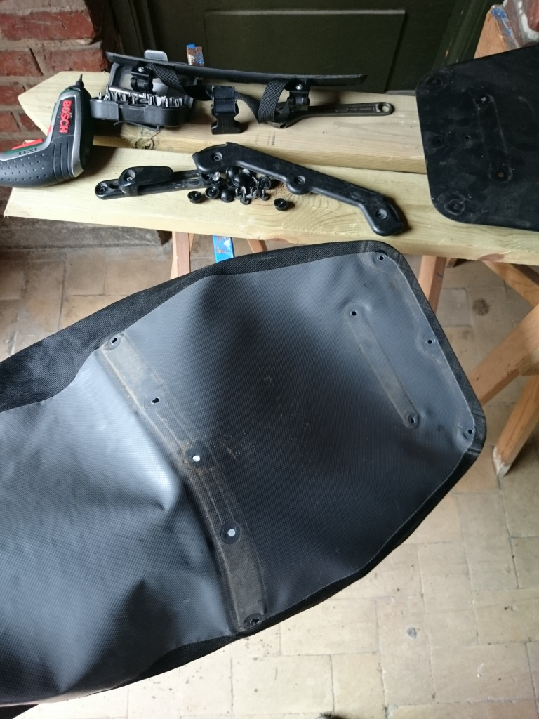 With all screws and fittings removed, the pannier is turned inside-out before the patch is added.